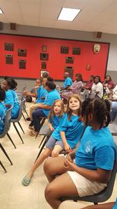 Chapter H participating in the Ears program graduation ceremony